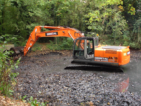We use heavy machinery where necessary to remove silt and sludge for disposal.