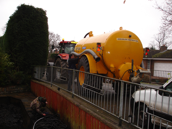 Tractor and suction tanker, well suited to confined situations.