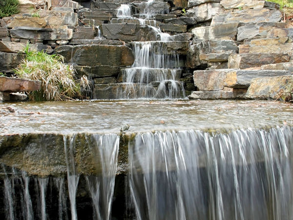 Waterfalls can be a calming presence, as well as enriching water oxygen levels.